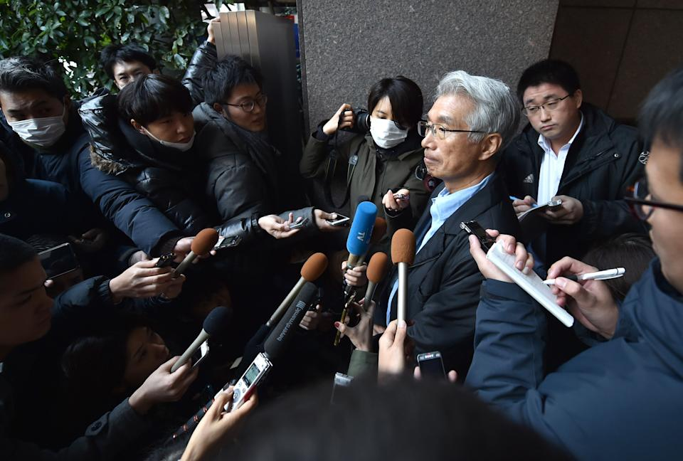 "The Japanese lawyer for former auto tycoon Carlos Ghosn, Junichiro Hironaka (centre R), speaks to the media outside his office in Tokyo on December 31, 2019. - Ghosn said on December 31 he had ""escaped injustice"" in Japan, where he was on bail awaiting trial on financial misconduct charges, and had fled to Lebanon. (Photo by Kazuhiro NOGI / AFP) (Photo by KAZUHIRO NOGI/AFP via Getty Images)"