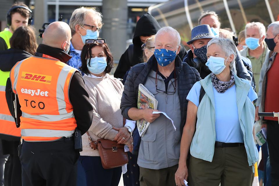 Passengers prepare to board an easyJet flight to Faro, Portugal, at Gatwick Airport in West Sussex after the ban on international leisure travel for people in England was lifted following the further easing of lockdown restrictions. Picture date: Monday May 17, 2021.
