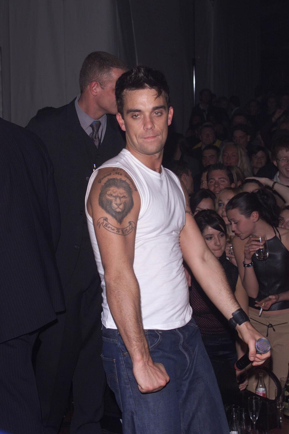 STOCKHOLM - NOVEMBER 16: British pop star Robbie Williams celebrates at the MTV after show party at the Grand Hotel on November 16, 2000 in Stockholm, Sweden. (Photo by Dave Hogan/Getty Images)
