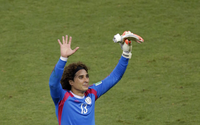 Mexico's goalkeeper Guillermo Ochoa waves to fans after the group A World Cup soccer match between Brazil and Mexico at the Arena Castelao in Fortaleza, Brazil, Tuesday, June 17, 2014