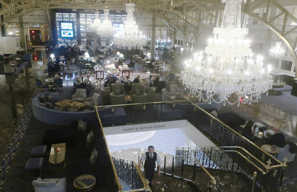 People gather in the Trump International Hotel on February 03, 2020 in Washington, DC. (Mario Tama/Getty Images)