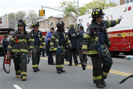 New York City firefighters attend an emergency after an F train derailed in Woodside, New York, May 2, 2014. REUTERS/Eduardo Munoz