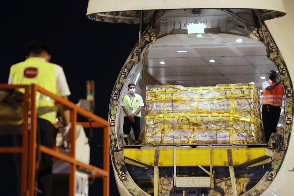 The first batch of Pfizer-BioNTech COVID-19 vaccines being unloaded from the plane upon its arrival in Singapore. (PHOTO: Ministry of Communication and Information)