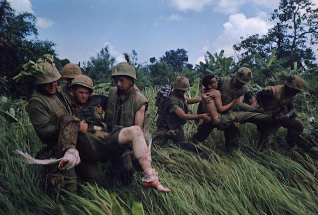 <p>Recovery of wounded under fire, near Hill 484, Operation Prairie, October 1966. (Photograph by Larry Burrows) </p>