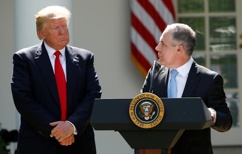 Trump and Pruitt in the White House Rose Garden at the president's announcement of the United States' withdrawal from the Paris climate accord last June.  (Kevin Lamarque / Reuters)