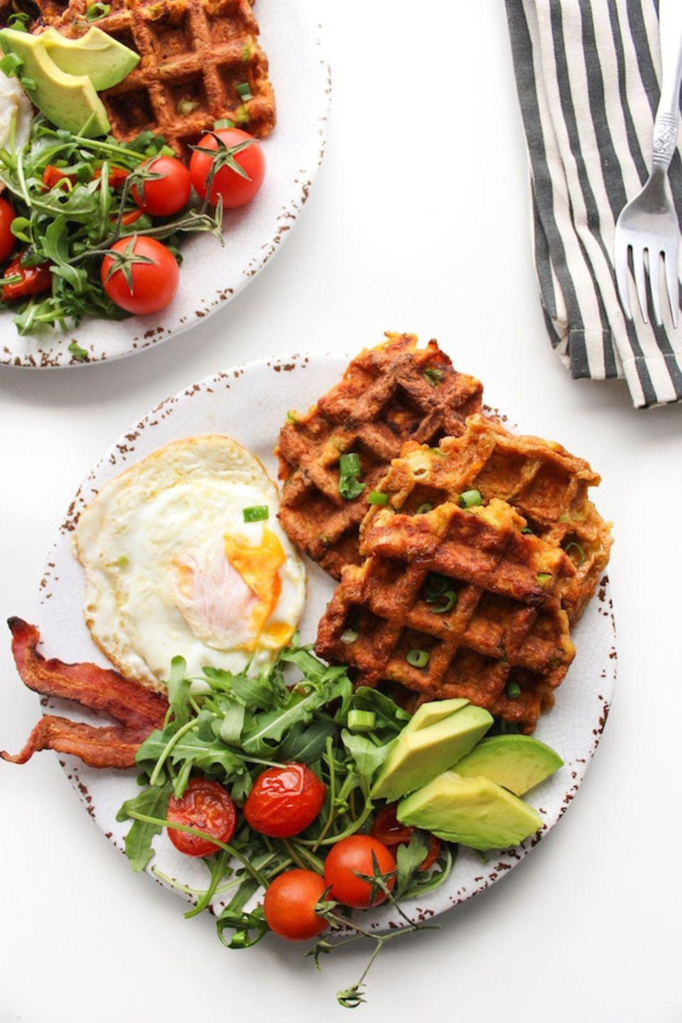 """<p>Pair your healthy waffles with bacon and eggs for an unforgettably delicious wake-up call.</p><p><strong>Get the recipe at <a href=""""https://www.asaucykitchen.com/paleo-sweet-potato-waffles/"""" rel=""""nofollow noopener"""" target=""""_blank"""" data-ylk=""""slk:A Saucy Kitchen"""" class=""""link rapid-noclick-resp"""">A Saucy Kitchen</a>.</strong><br></p><p><strong><a class=""""link rapid-noclick-resp"""" href=""""https://www.amazon.com/dp/B003ZHU8M0?tag=syn-yahoo-20&ascsubtag=%5Bartid%7C10050.g.877%5Bsrc%7Cyahoo-us"""" rel=""""nofollow noopener"""" target=""""_blank"""" data-ylk=""""slk:SHOP GRATERS"""">SHOP GRATERS</a><br></strong></p>"""