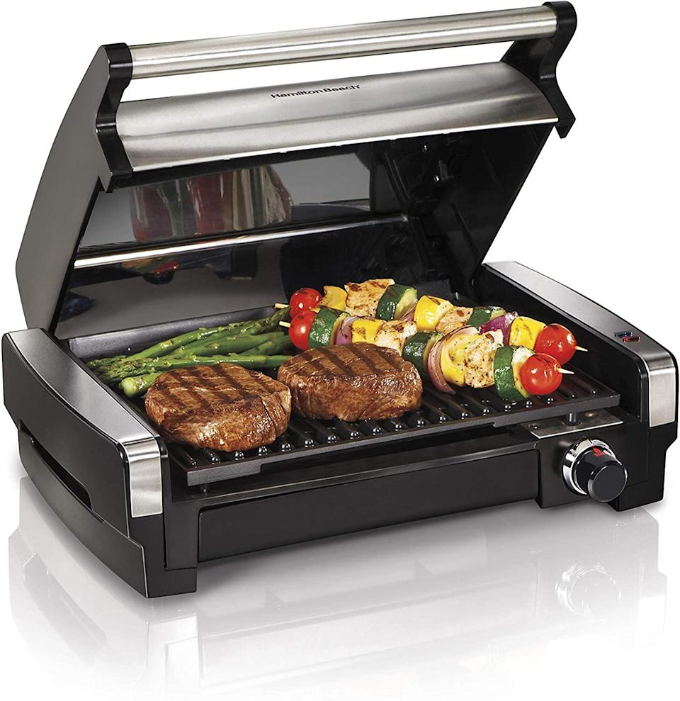 """<h2>Best Grill For Indoors<br></h2><br><h3>Hamilton Beach Electric Indoor Searing Grill <br></h3><br><strong>The Hype:</strong> 4.7 out of 5 stars and 172 ratings on <a href=""""https://www.overstock.com/Home-Garden/Hamilton-Beach-Indoor-Searing-Grill-with-Lid-Window/11703255/product.html"""" rel=""""nofollow noopener"""" target=""""_blank"""" data-ylk=""""slk:Overstock"""" class=""""link rapid-noclick-resp"""">Overstock</a><br><br><strong>BBQ Buffs Say</strong>: """"I was looking for an indoor grill to replace my George Foreman. I was very pleased to find this one with both the searing function and the glass window to watch the food as it cooks. I trust the Hamilton Beach name and it was cheaper here on Overstock than on other retail sites. I've used it now for months and no issues. Clean-up is also a snap!""""<br><br><strong>Hamilton Beach</strong> Indoor Searing Grill, $, available at <a href=""""https://go.skimresources.com/?id=30283X879131&url=https%3A%2F%2Fwww.overstock.com%2FHome-Garden%2FHamilton-Beach-Indoor-Searing-Grill-with-Lid-Window%2F11703255%2Fproduct.html"""" rel=""""nofollow noopener"""" target=""""_blank"""" data-ylk=""""slk:Overstock"""" class=""""link rapid-noclick-resp"""">Overstock</a>"""