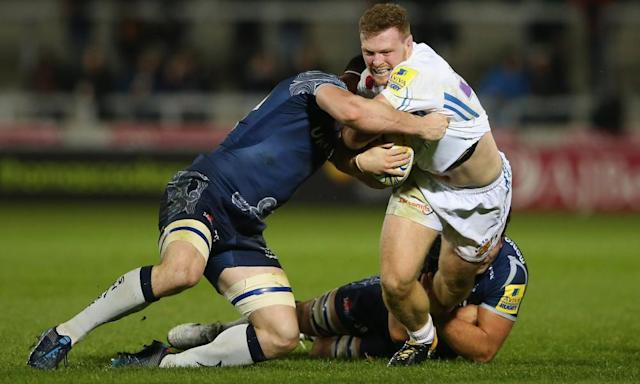 """<span class=""""element-image__caption"""">Exeter Chiefs' Sam Simmonds is tackled by Tom Curry and Jono Ross of Sale Sharks on Friday night.</span> <span class=""""element-image__credit"""">Photograph: Alex Livesey/Getty Images</span>"""