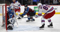 Colorado Avalanche goaltender Pavel Francouz, left, stops a shot off the stick of New York Rangers right wing Pavel Buchnevich during the second period of an NHL hockey game Wednesday, March 11, 2020, in Denver. (AP Photo/David Zalubowski)