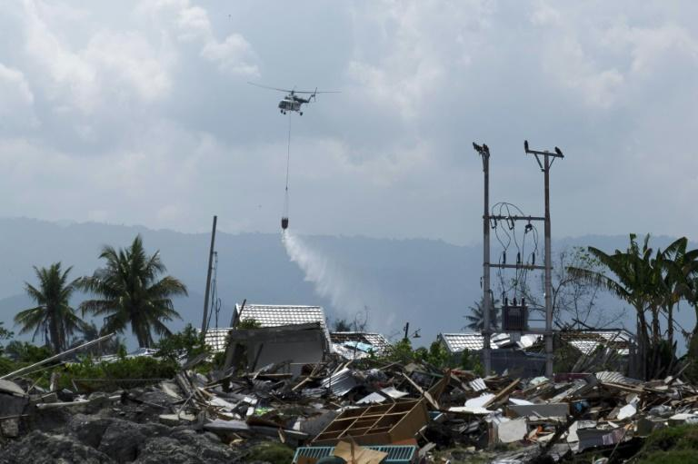 Desperate to stave off disease, authorities last week dropped disinfectant from helicopters on the worst-hit parts of Palu