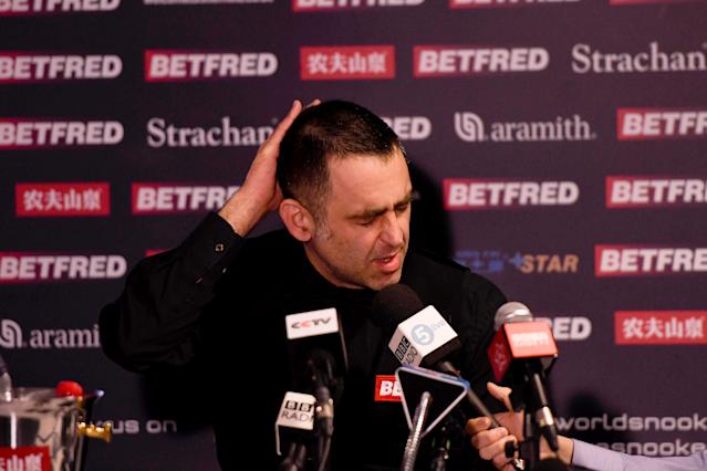 Ronnie O'Sullivan faces the media after his defeat to James Cahill. (Credit: Getty Images)