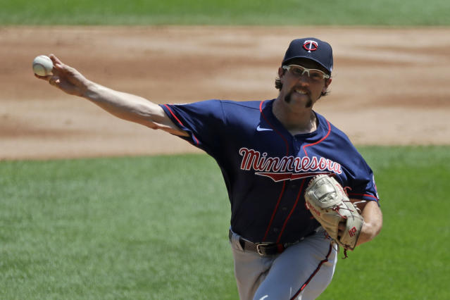 Minnesota Twins starting pitcher Randy Dobnak throws the ball against the Chicago White Sox during the first inning of a baseball game in Chicago, Saturday, July 25, 2020. (AP Photo/Nam Y. Huh)
