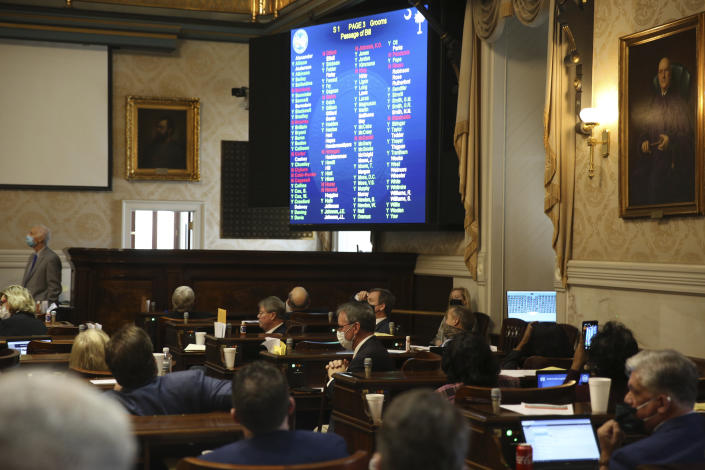 South Carolina Rep. David Hiott, R-Pickens, says a prayer as the House votes on a bill that would ban most abortions in the state on Wednesday, Feb. 17, 2021 in Columbia, S.C. The bill will soon go to the governor. (AP Photo/Jeffrey Collins)