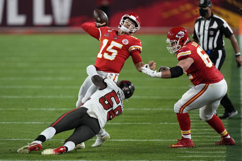 Kansas City Chiefs quarterback Patrick Mahomes passes under pressure from Tampa Bay Buccaneers outside linebacker Shaquil Barrett during the second half of the NFL Super Bowl 55 football game, Sunday, Feb. 7, 2021, in Tampa, Fla. (AP Photo/David J. Phillip)