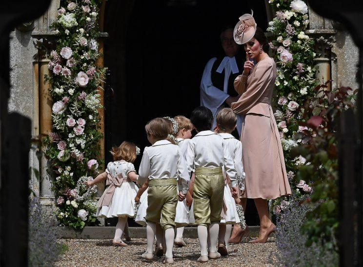 The Duchess of Cambridge gentle shushes the children's bridal party at her sister Pippa Middleton's wedding [Photo: PA]