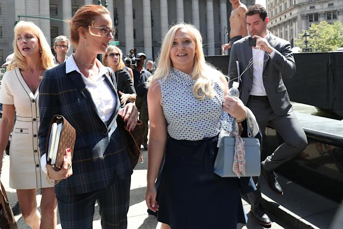 Virginia Giuffre (centre) walks after a hearing in the criminal case against Jeffrey Epstein in August 2019. (Reuters/Shannon Stapleton)