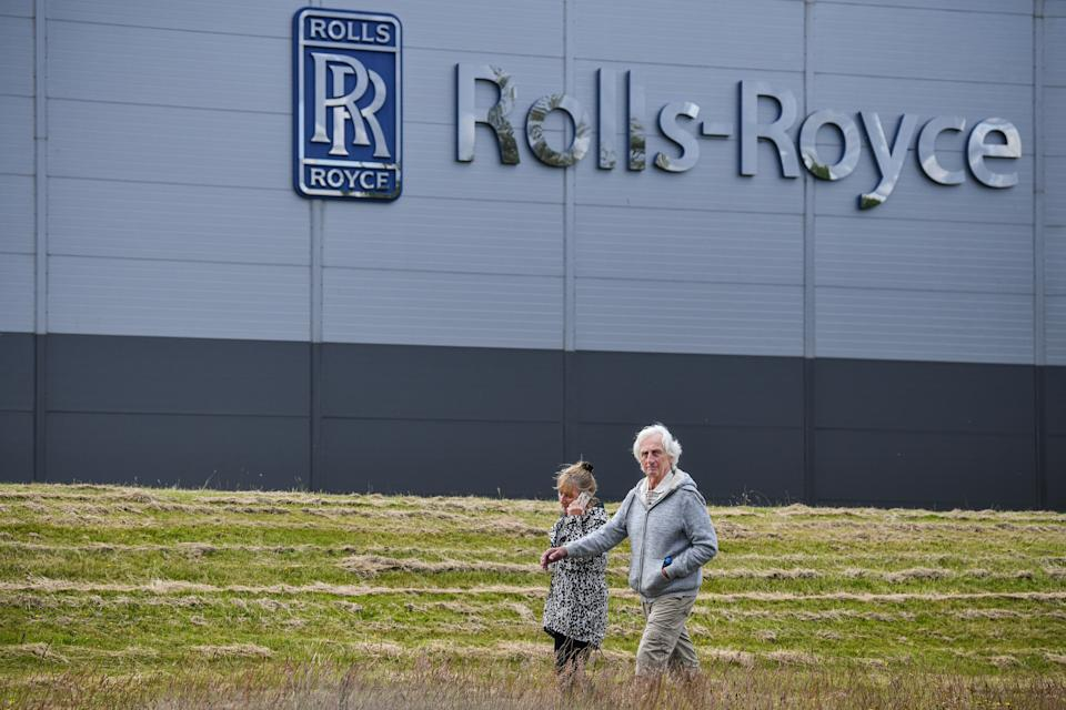 INCHINNAN, SCOTLAND - JUNE 11: People walk past the Rolls Royce Inchinan factory on June 11, 2020 in Inchinnan, Scotland. Jet engine manufacturer Rolls-Royce is expected to cut 20% of it's workforce, including 700 jobs at the Inchinnan plant, following a sharp decline in business as a result of the coronavirus outbreak. (Photo by Jeff J Mitchell/Getty Images)