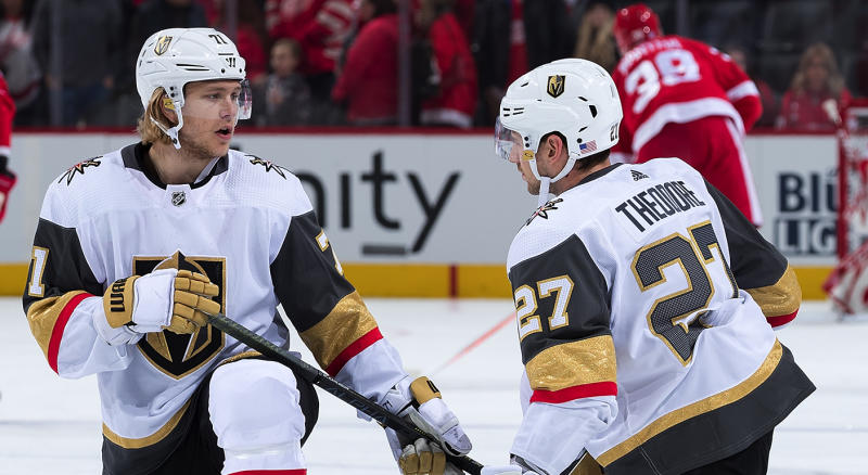 DETROIT, MI - NOVEMBER 10: William Karlsson #71 and Shea Theodore #27 of the Vegas Golden Knights chat and stretch during warm-ups prior to an NHL game against the Detroit Red Wings at Little Caesars Arena on November 10, 2019 in Detroit, Michigan. (Photo by Dave Reginek/NHLI via Getty Images)
