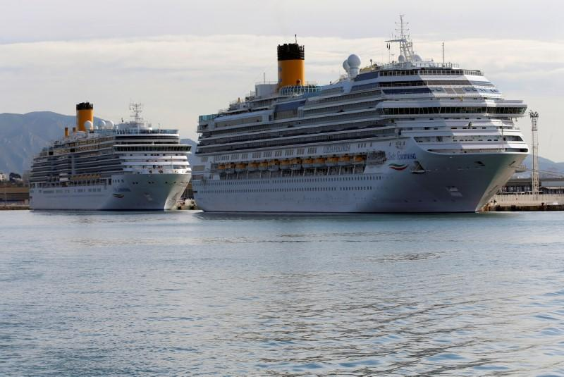 FILE PHOTO: A view shows the Costa Luminosa and Costa Fascinosa cruise ships moored at the Grand Port Maritime Marseille (GPMM), in Marseille