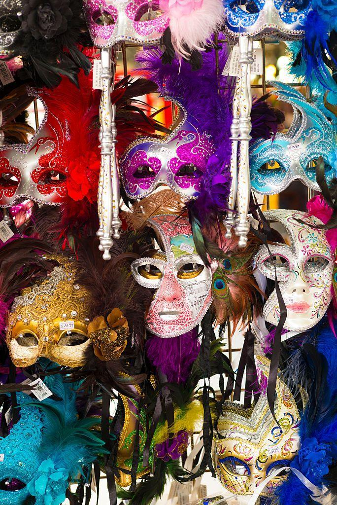 """<p>From eye-obscuring tie-ons to full-face numbers that resemble a jester's getup, this is one of the traditions partly inspired by the customs of the <a href=""""https://venice-carnival-italy.com/"""" rel=""""nofollow noopener"""" target=""""_blank"""" data-ylk=""""slk:Carnival of Venice"""" class=""""link rapid-noclick-resp"""">Carnival of Venice</a>. In the early days of the festival, male aristocratic krewe members and other celebrants wore the masks to protect their reputations amid the debauchery (the less fortunate, and women, <a href=""""https://www.mardigrasneworleans.com/history/traditions/mardi-gras-masks"""" rel=""""nofollow noopener"""" target=""""_blank"""" data-ylk=""""slk:were reportedly judged"""" class=""""link rapid-noclick-resp"""">were reportedly judged</a> for wearing them). Mask use is even regulated by Louisiana law: It's actually <a href=""""https://www.nola.com/news/politics/article_f4662468-604f-5cf4-9d9c-06ffeeef36dc.html"""" rel=""""nofollow noopener"""" target=""""_blank"""" data-ylk=""""slk:illegal to wear them"""" class=""""link rapid-noclick-resp"""">illegal to wear them</a>, and one of the few exceptions is for Mardi Gras. </p>"""