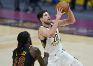 Indiana Pacers' Doug McDermott (20) drives to the basket against Cleveland Cavaliers' Taurean Prince (12) during the second half of an NBA basketball game Wednesday, March 3, 2021, in Cleveland. (AP Photo/Tony Dejak)