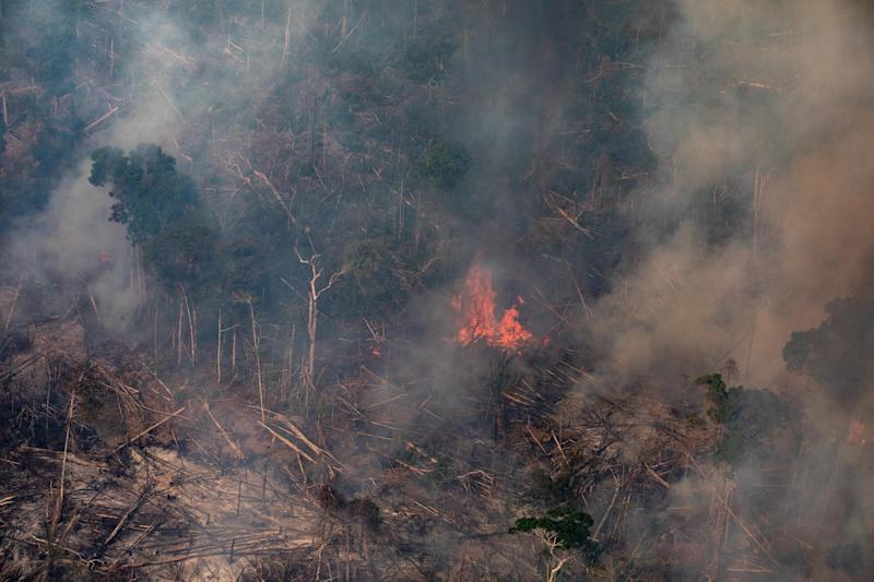 PORTO VELHO, RONDONIA, BRAZIL - AUGUST 25: In this aerial image, a fire burns in a section of the Amazon rain forest on August 25, 2019 in the Candeias do Jamari region near Porto Velho, Brazil. According to INPE, Brazil's National Institute of Space Research, the number of fires detected by satellite in the Amazon region this month is the highest since 2010. (Photo by Victor Moriyama/Getty Images)