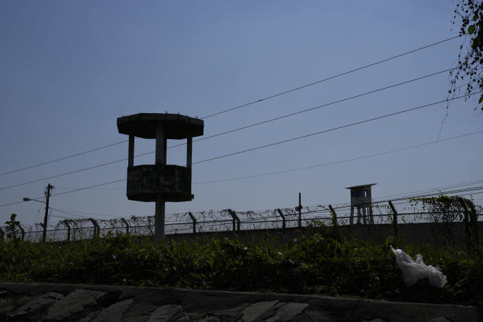 A watch tower stands empty inside Litoral Penitentiary after deadly fights inside the jail in Guayaquil, Ecuador, Thursday, July 22, 2021. Rival gangs of inmates fought in two prisons in Ecuador, killing at least 18 people and injuring dozens, authorities said Thursday. (AP Photo/Dolores Ochoa)