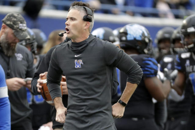 Memphis head coach Mike Norvell yells to his players in the first half of an NCAA college football game against Cincinnati, Friday, Nov. 29, 2019, in Memphis, Tenn. (AP Photo/Mark Humphrey)