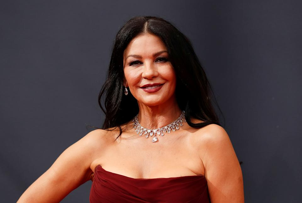 Actor Catherine Zeta-Jones arrives at the 73rd Primetime Emmy Awards in Los Angeles wearing a red strapless gown and a diamond necklace