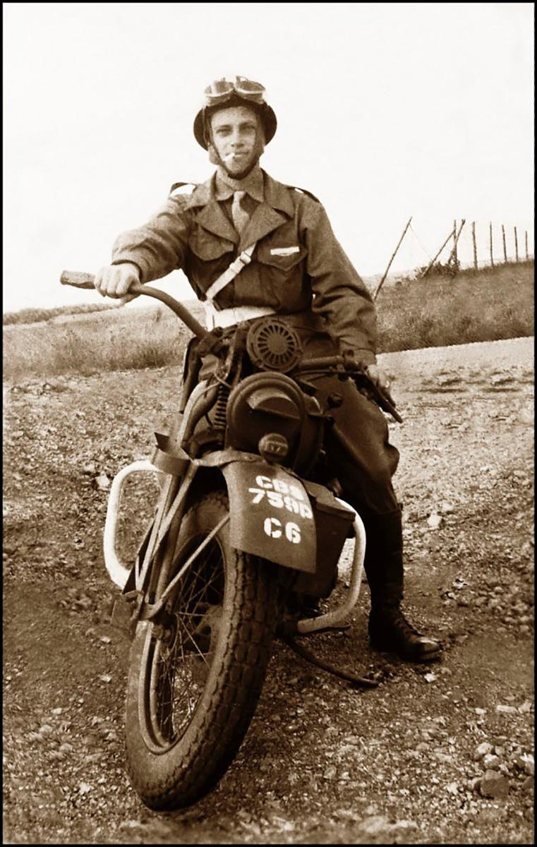 Pfc Norman Riggsby sitting on his Harley Davidson during the European campaign. After receiving wounds in Normandy, Riggsby transferred to the Military Police. | The National WWII Museum