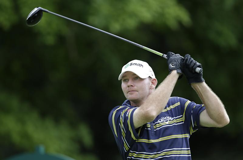 Tommy Gainey watches his tee shot on the 12th hole during the first round of the Greenbrier Classic golf tournament in White Sulphur Springs, W.Va., Thursday, July 4, 2013. Gainey finished the round at 8-under-par 62. (AP Photo/Steve Helber)