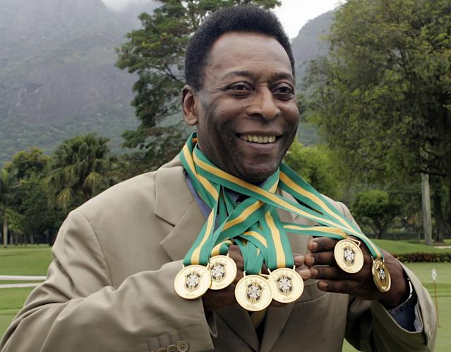 (FILE) Brazilian football legend Edson Arantes do Nascimento, known as 'Pele', poses with his six Brazil's champion medals on December 22, 2010 during a ceremony in Rio de Janeiro, Brazil. Football legend Pele is hospitalized in Sao Paulo, Brazil, a spokesperson of the Albert Einstein Hospital confirmed on November 13, 2012. According to Sao Paulo's Folha newspaper, Pele underwent a hip surgery to correct a problem on his thighbone. AFP PHOTO/CAIO LEALCAIO LEAL/AFP/Getty Images