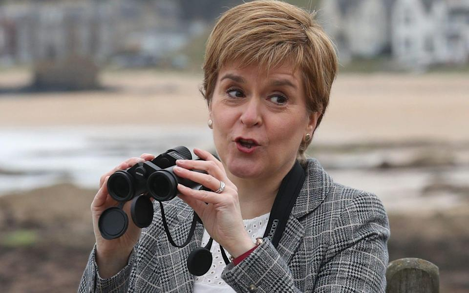 First Minister Nicola Sturgeon uses binoculars during a visit to the Scottish Seabird Centre, North Berwick, on the campaign trail for the Scottish Parliamentary election. Picture date: Monday April 26, 2021. PA Photo. See PA story SCOTLAND Election. - Andrew Milligan/PA Wire
