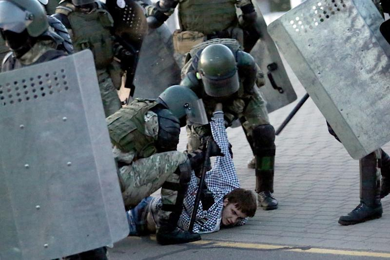 Police detain a man during an opposition rally in Minsk (TUT.BY/AFP via Getty Images)