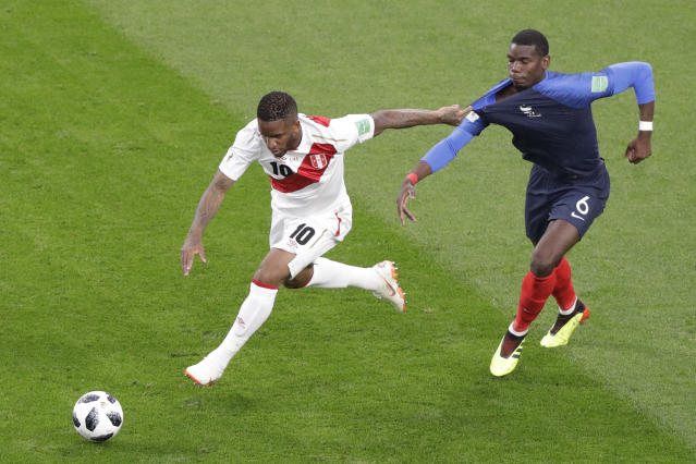 Peru's Jefferson Farfan, left, and France's Paul Pogba challenge for the ball during the group C match between France and Peru at the 2018 soccer World Cup in the Yekaterinburg Arena in Yekaterinburg, Russia, Thursday, June 21, 2018. (AP Photo/Mark Baker)