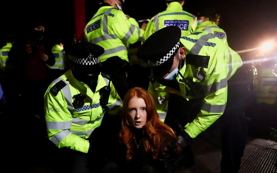 Police detained a woman as people gathered at the memorial site in Clapham Common Bandstand - Hannah McKay/Reuters