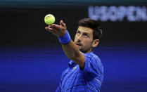 Novak Djokovic, of Serbia, tosses the ball on a serve to Denis Kudla, of the United States, during the third round of the U.S. Open tennis tournament Friday, Aug. 30, 2019, in New York. (AP Photo/Charles Krupa)