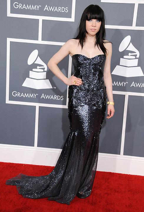 Carly Rae Jepsen didn't think twice about calling (maybe) Roberto Cavalli for a dress at the Grammys. She accessorized her glittering black gown with gold accessories.