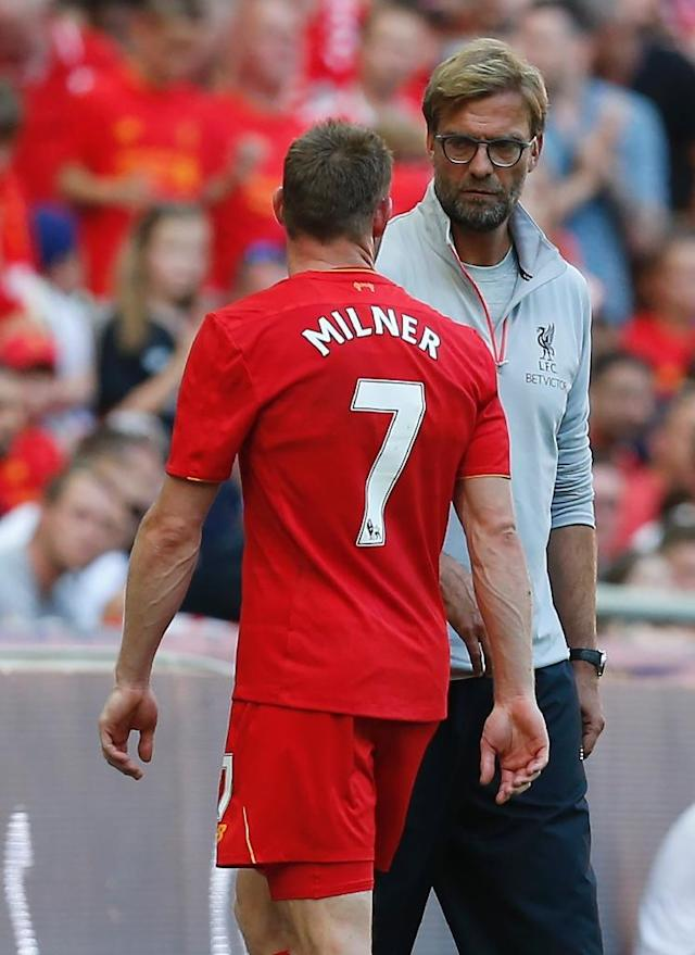 Liverpool's midfielder James Milner (L) talks to manager Jurgen Klopp as he is substituted shortly before half-time on August 6, 2016 (AFP Photo/Ian Kington)