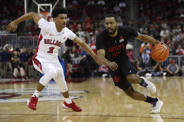 Fresno State's Jarred Hyder defends against San Diego State's KJ Feagin during the first half of an NCAA college basketball game in Fresno, Calif., Tuesday Jan. 14, 2020. (AP Photo/Gary Kazanjian)