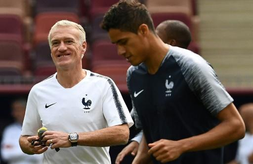 Raphael Varane (R) is likely to captain France as Didier Deschamps (L) rotates his squad for the Denmark game