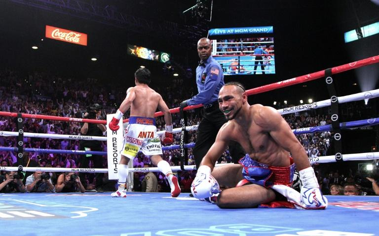 Pacquiao floored Thurman with an electrifying combination in the first round and remained on the front foot throughout a pulsating 12-round duel (AFP Photo/John Gurzinski)