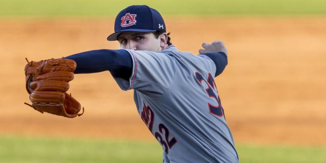 FILE - In this April 20, 2018, file photo, Auburn pitcher Casey Mize throws against Auburn during an NCAA college baseball game against Alabama, in Tuscaloosa, Ala. Mize has risen from an undrafted high school player to a potential No. 1 overall pick, adding pitches to his repertoire and striking out 119 batters while walking only seven. (Vasha Hunt/AL.com via AP, File)