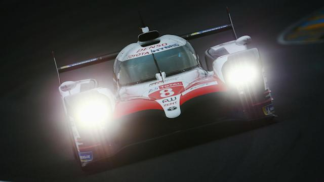 Fernando Alonso moved a step closer to completing the 'Triple Crown' of motorsport by winning at Le Mans on Sunday.