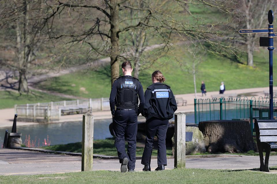 Police officers walk through Mote Park in Maidstone, Kent, the day after Prime Minister Boris Johnson put the UK in lockdown to help curb the spread of the coronavirus. (Photo by Gareth Fuller/PA Images via Getty Images)