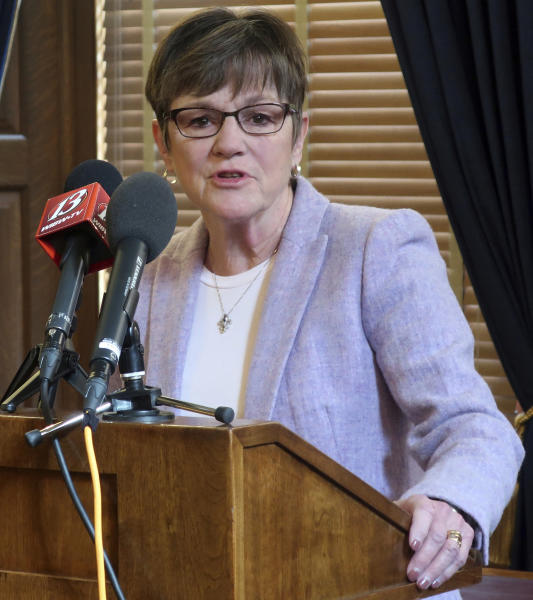 FILE - In this Thursday, March 7, 2019 file photo, Kansas Gov. Laura Kelly answers questions during a news conference at the Statehouse in Topeka, Kansas. The Democratic governor has vetoed a tax relief bill approved by the Republican-controlled Legislature, saying that it would return her red state to a nationally infamous fiscal experiment under her GOP predecessors. The bill was aimed at preventing individuals and businesses from paying more in state income taxes because of changes in federal tax laws at the end of 2017. (AP Photo/John Hanna, File)
