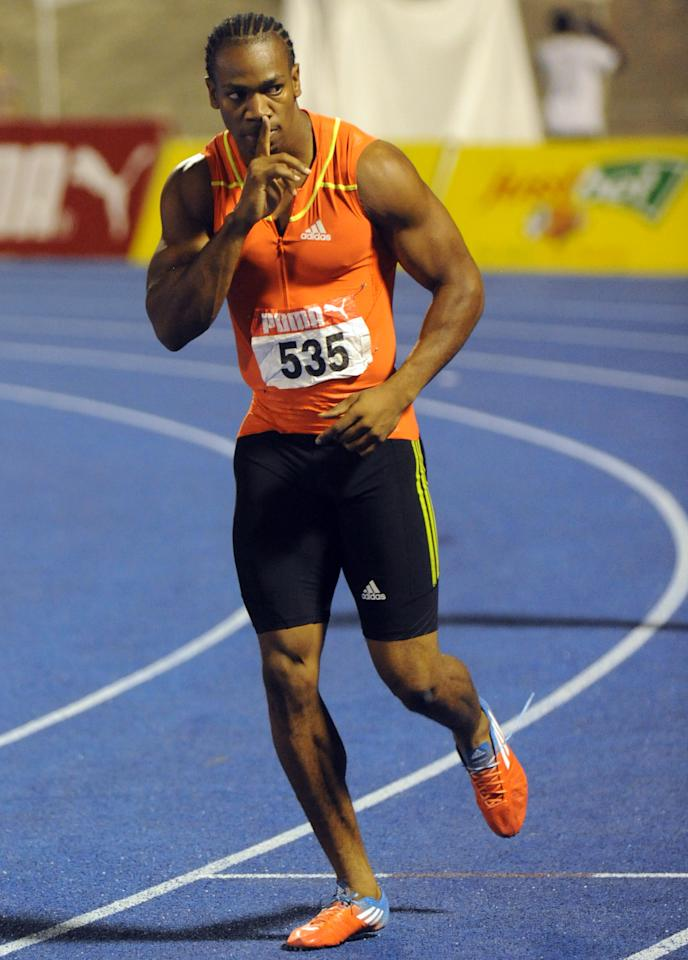 Sprinter Yohan Blake gestures to the crowd after winning the 200m final at Jamaica's Olympic trials in Kingston, Jamaica, Sunday, July 1, 2012. Blake edged world-record holder Usain Bolt by 0.03 finishing in 19.80 seconds. (AP Photo/Collin Reid)