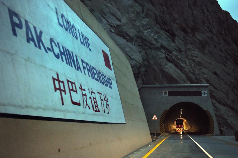 To go with story 'Pakistan-China-economy-transport, FEATURE' by Guillaume LAVALLÉE  In this photograph taken on September 29, 2015, a loaded truck travels through a newly built tunnel in northern Pakistan's Gojal Valley.  A glossy highway and hundreds of lorries transporting Chinese workers by the thousands: the new Silk Road is under construction in northern Pakistan, but locals living on the border are yet to be convinced they will receive more from it than dust.    AFP PHOTO / Aamir QURESHI        (Photo credit should read AAMIR QURESHI/AFP via Getty Images)