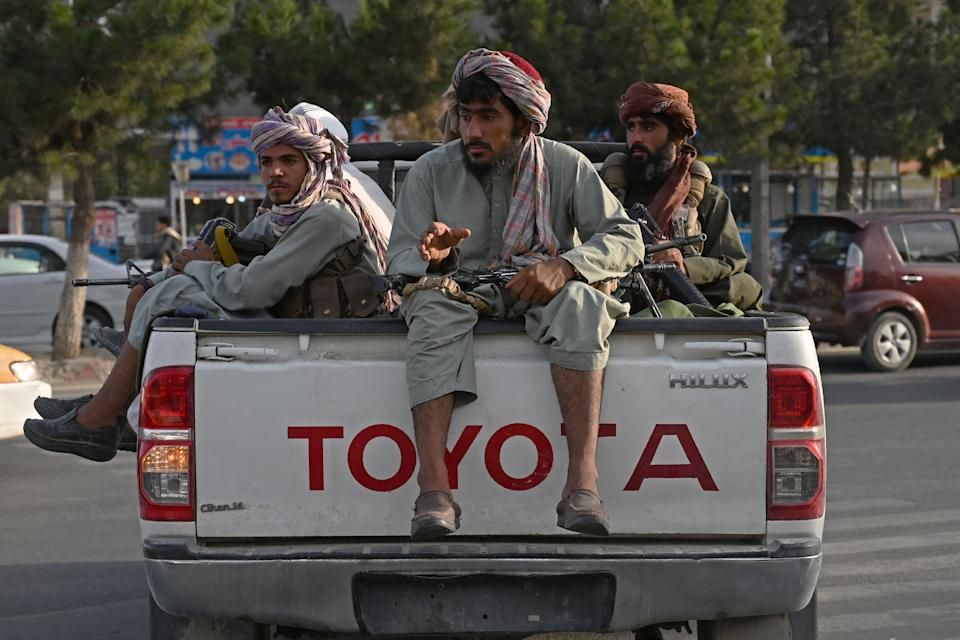 Taliban fighters in a truck patrol the streets of Kabul on Monday. The Taliban have enforced some sense of calm in a city long subject to violent crime, with their armed forces patrolling the streets and manning checkpoints.