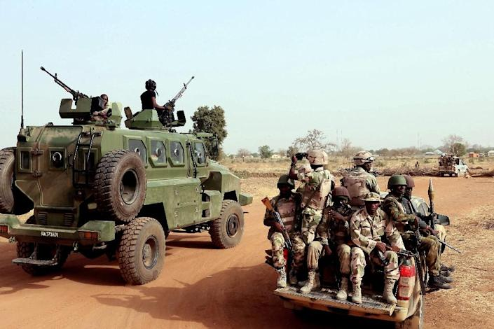 Nigerian army soldiers along a road in Chibok, northeastern Nigeria, on March 5, 2015 (AFP Photo/Sunday Aghaeze)